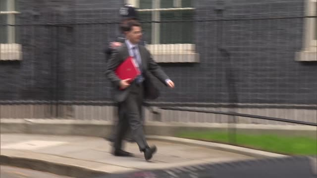 cabinet departures alternative angle england london westminster downing street ext sajid javid mp walking away / damian hinds mp away / james... - damian hinds stock videos and b-roll footage