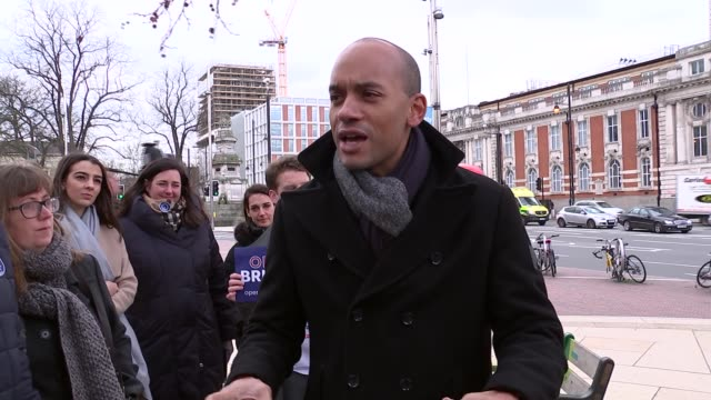 Chuka Umunna campaigns in Brixton ENGLAND London Brixton EXT Chuka Umunna MP arriving greeting activists and speaking SOT Umunna and others along /...