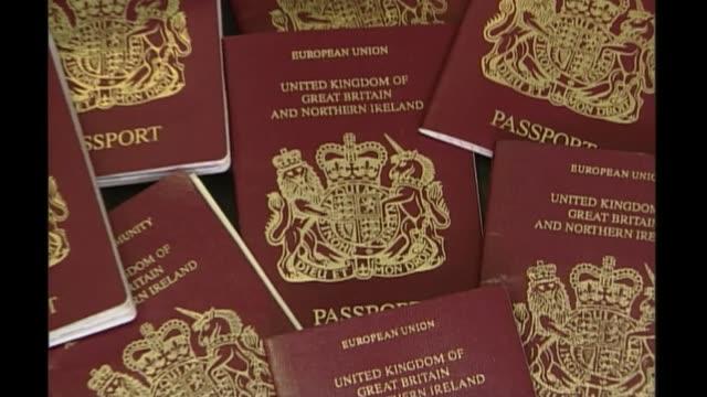 design for new blue passports revealed bsp291000013 / london int gv passports zoom in close shot passport - パスポート点の映像素材/bロール