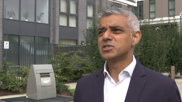 draft of government plans for immigration leaked from home office london ext sadiq khan visiting sousing construction site with others/ sadiq khan... - sadiq khan stock videos & royalty-free footage
