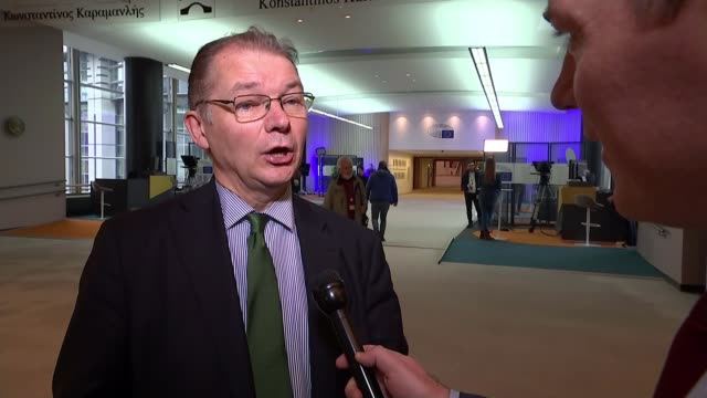 stockvideo's en b-roll-footage met eu and uk hold first postbrexit trade talks belgium brussels int philippe lamberts mep set up shot with reporter / interview sot - politics