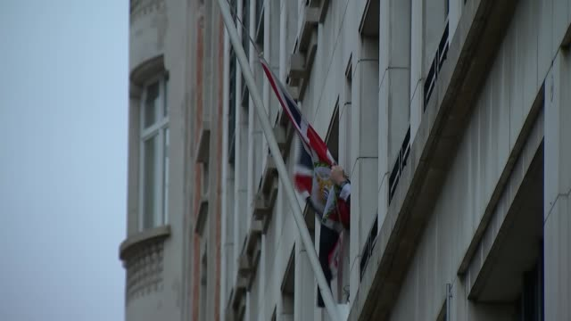 stockvideo's en b-roll-footage met eu flag lowered from british mission in brussels belgium brussels ext gvs eu flag removed from flagpole outside the uk mission to the eu - politics