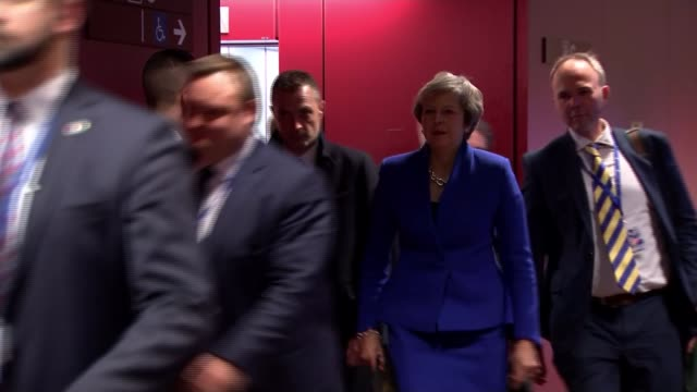 EU leaders agree Brexit deal at Brussels summit BELGIUM Brussels European Council INT Theresa May MP along corridor with aides and into press...