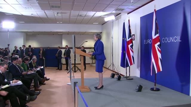 EU leaders agree Brexit deal at Brussels summit BELGIUM Brussels INT Various cutaways of Theresa May MP press conference arriving to podium Union...