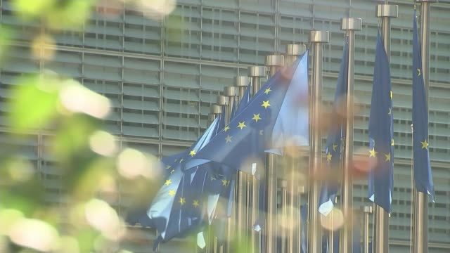 EU leaders respond to Theresa May's decision to delay UK Parliament's vote on Brexit deal BELGIUM Brussels European Commission EXT EU flags flying...
