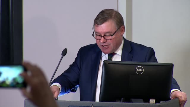 offer could shift uk's departure back to the end of the year; england: london: int close shot of man listening at bruges group press conference back... - pamphlet stock videos & royalty-free footage