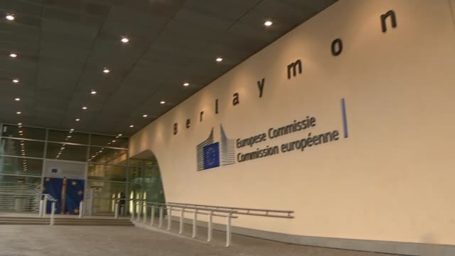 eu offer could shift uk's departure back to the end of the year belgium brussels ext general views outside european commission building eu flags on... - europäische kommission stock-videos und b-roll-filmmaterial