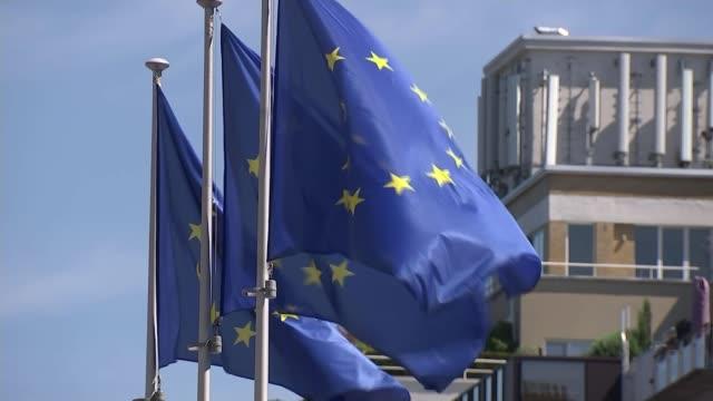 eu reaction to boris johnson's conservative party leadership victory belgium brussels berlaymont gvs belgium brussels ext eu flag plaque on... - 欧州共同体点の映像素材/bロール