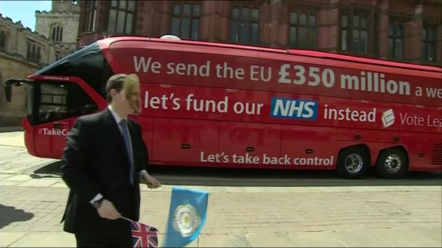 battle for conservative party leadership lib / north yorkshire york ext man wearing boris johnson mask waving flag in front of 'vote leave' battle bus - north york stock videos & royalty-free footage