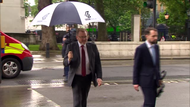 Cabinet arrivals and departures ENGLAND London Whitehall PHOTOGRAPHY*** David Mundell MP along past / Michael Fallon MP crosses road with umbrella...