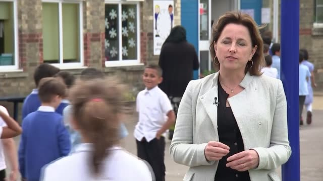 concerns of immigrant community in peterborough england cambridgeshire peterborough the beeches primary school ext various of schoolchildren entering... - vox populi stock-videos und b-roll-filmmaterial