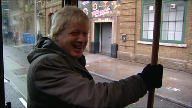 conservative party leadership fox and crabb are the first to announce candidacies date boris johnson on routemaster bus and waving as past on bicycle... - boris johnson stock videos and b-roll footage