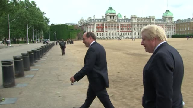 david cameron addresses commons / conservative party leadership ext boris johnson mp walking across horse guards parade with unidentified man towards... - horse guards parade stock videos and b-roll footage