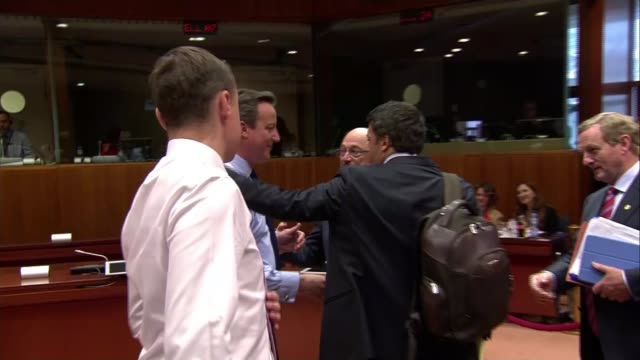 david cameron at eu summit / nigel farage jeered in european parliament belgium brussels ext estonian prime minister taavi roivas patting prime... - hands behind back stock videos and b-roll footage