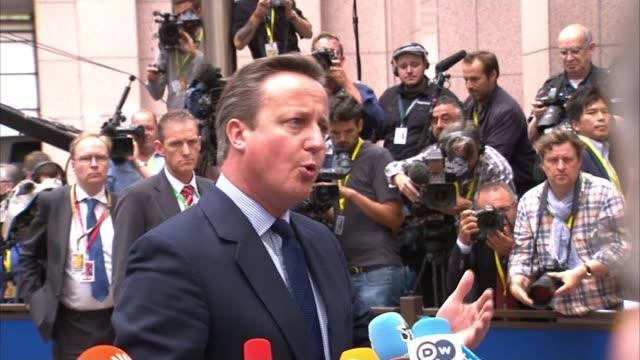 david cameron at eu summit / nigel farage jeered in european parliament; prime minister david cameron speaking to press outside eu summit sot - i'll... - decidere video stock e b–roll