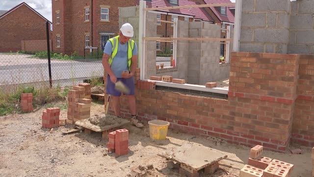 housing construction and help to buy england oxfordshire ext gvs houses under construction including builders at work / close shots of bricklayer... - construction material stock videos & royalty-free footage