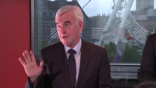 John McDonnell speech and cutaways John McDonnell MP Q A session SOT / cutaways of McDonnell sitting / various cutaways of McDonnell at podium /...