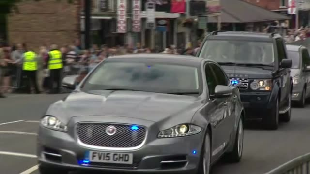 political developments england lincolnshire cleethorpes ext motorcade arriving wide shot of cameron arriving at building as heckler heard shouting... - motorcade stock videos & royalty-free footage