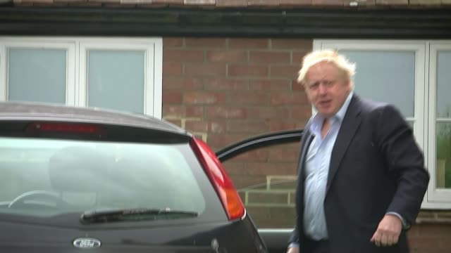 political developments oxfordshire boris johnson putting luggage into car outside his country house waves to unseen press photographers and looks... - thunderstorm stock videos & royalty-free footage