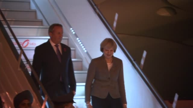 Theresa May backs right of newspapers to criticize High Court judges ****FLASH INDIA Delhi May and Fox down steps from aircraft on arrival and greeted