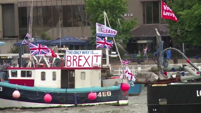 stockvideo's en b-roll-footage met brexit flotilla of fishing boats sails up the river thames into london with foghorns sounding in a protest against eu fishing quotas by the campaign... - referendum over europese unie 2016
