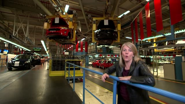 ford boss warns of impact of tariffs / effects on car manufacturing process germany cologne ford car plant ext various of cover pulled back from... - dagenham stock videos & royalty-free footage
