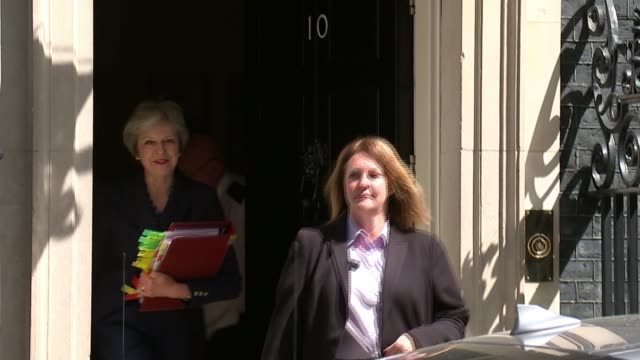 government row over backstop plan for customs arrangements england london downing street ext prime minister theresa may mp to car from number 10 as... - prime minister's questions stock-videos und b-roll-filmmaterial