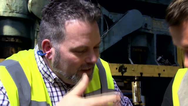 government sets out plans for future customs system with eu england warwickshire int workers at machine at metal pressing workshop various of workers... - warwickshire stock videos & royalty-free footage