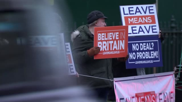 Growing demands to block 'no deal' / no deal lorry rehearsal ENGLAND London Westminster EXT Various shots of group of Remain protesters gathered...