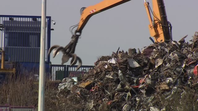 honda confirm swindon factory workers will lose their jobs by 2021 england wiltshire swindon ext landfill claw moving scrap diggers moving waste in... - honda stock videos & royalty-free footage