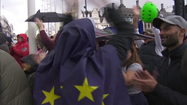 hundreds of thousands march to demand second referendum england london westminster protesters wearing flags over heads cheering as letwin amendment... - cape stock videos & royalty-free footage