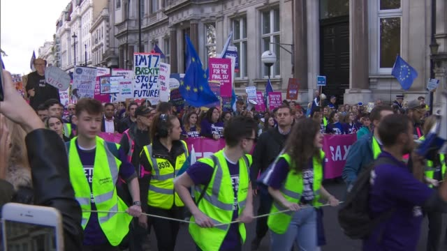 hundreds of thousands march to demand second referendum england london westminster ext people's vote protester marching towards with banner - referendum stock videos & royalty-free footage