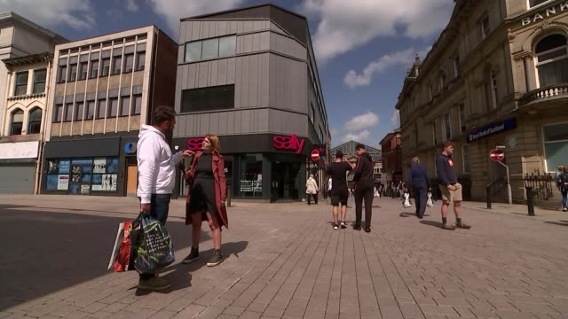 Jeremy Corbyn says he has plan to save Britain's high streets from retail apocalypse ENGLAND Greater Manchester Bolton EXT Vox pops with reporter...