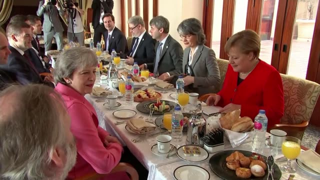 Labour move to back second EU referendum EGYPT Sharm El Sheikh INT Various Theresa May MP eating breakfast with Angela Merkel and others...