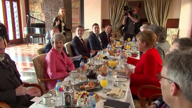 labour move to back second eu referendum egypt sharm el sheikh int various theresa may mp eating breakfast with angela merkel and other eu27 leaders - eating stock videos & royalty-free footage