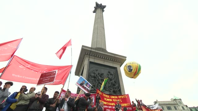 labourconservative talks over brexit compromise ongoing england london trafalgar square ext may day rally protesters with banner with pictures of... - continuity stock videos & royalty-free footage