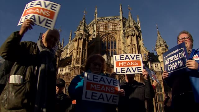 leave means leave protest outside houses of parliament england london westminster houses of parliament ext protesters with sign 'we voted leave' on... - flag stock videos & royalty-free footage