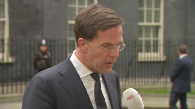 Mark Rutte speaking to press on Downing Street ENGLAND London Downing Street EXT Mark Rutte departing Number 10 and speaking to press SOT Mark Rutte...