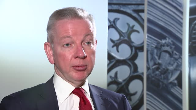 michael gove interview england london westminster int michael gove mp interview sot / close shots of british flag cufflinks being worn by gove - kansas stock videos & royalty-free footage