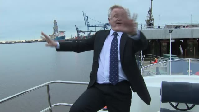 vídeos de stock, filmes e b-roll de ministers attempt to quell 'cabinet divisions' speculation; middlesbrough: ext david davis mp photocall standing on deck of boat on river tees - tees river