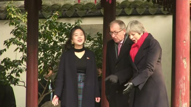 Ministers defend Theresa May's Brexit strategy CHINA Shanghai Yu Yuan Temple Garden EXT Theresa May MP and Phillip May along with tour guide Wide...
