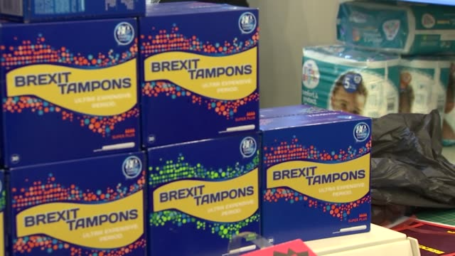 mock brexit-themed shop; england: london: peckham: ext mock products with satirical labels in mock pop-up brexit-themed shop including chicken, cans,... - label stock videos & royalty-free footage