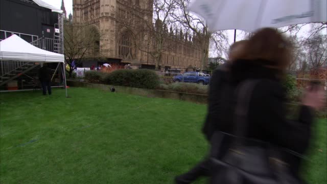 mps prepare to debate on no deal england london westminster various of protesters with flags and placards charles walker mp set up shot with reporter... - member of parliament stock videos & royalty-free footage