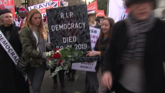 mps prepare to vote on amendments to theresa may's brexit plan england london westminster ext probrexit protesters towards with fake tombstone... - fake stock videos & royalty-free footage