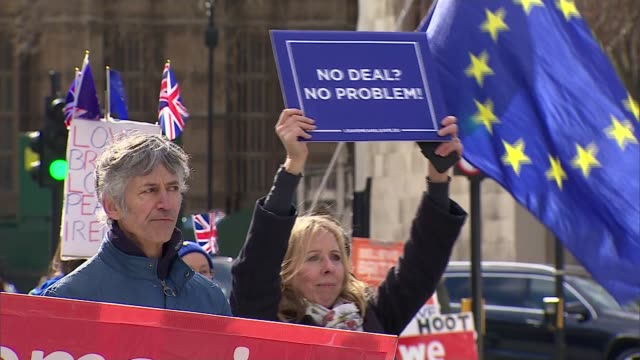MPs prepare to vote on series of nodeal amendments ENGLAND London Westminster EXT AntiBrexit protesters with EU flags outside Parliament ProBrexit...