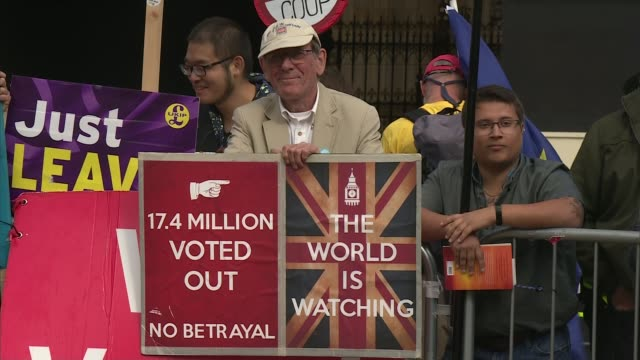 mps vote on bill to prevent no-deal brexit on october 31; england: london: westminster: ext various shots of protesters gathered outside parliament,... - 2016 european union referendum stock videos & royalty-free footage