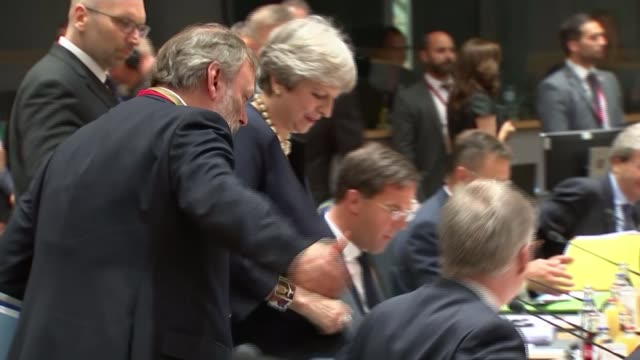 theresa may outlines plans on status of eu nationals living in uk theresa may and tim barrow to seats - european union stock videos & royalty-free footage