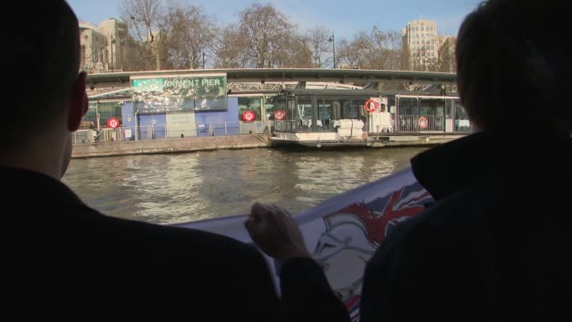 stockvideo's en b-roll-footage met nigel farage dumps dead fish into the river thames england london river thames ext fishing boat along the thames with 'fishing for leave' flag crates... - bob geldof