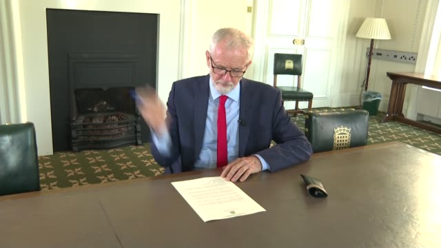 no deal opponents make pact to try to change law; england: london: westminster: church house: int various shots of jeremy corbyn mp signing letter... - jeremy corbyn stock videos & royalty-free footage