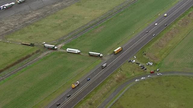 lorries at manston airport aerials england kent ramsgate lorries leaving manston airport / aerials lorries along dual carriageways - ramsgate stock videos and b-roll footage
